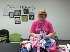 Lisa sorting clothing donations 1.9 (2)
